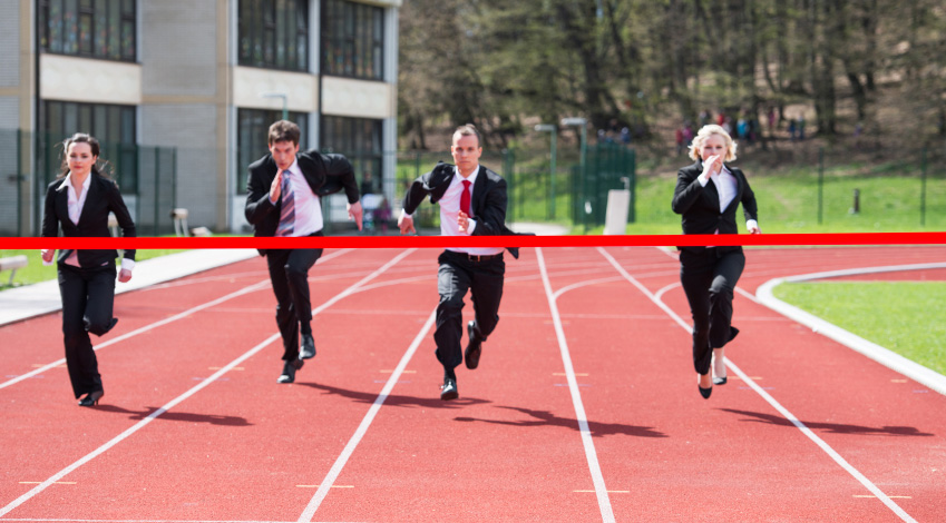 Runners sprinting to finish line