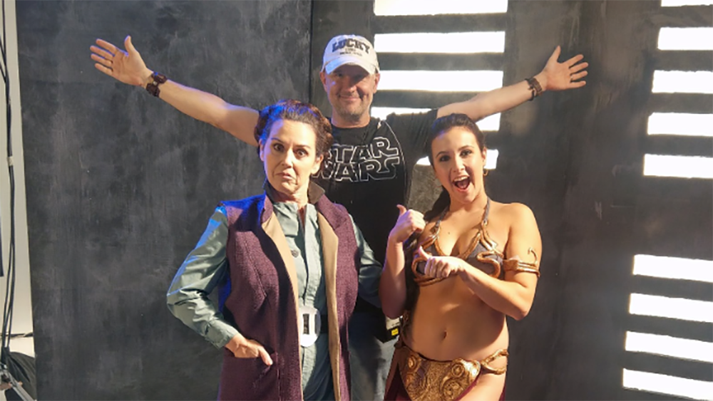 "Brad directing the Carrie Fisher episode of ""The Price of Fame"" with actors Shannon McGrann (left) and Tori Beaudoin (right) during a Star Wars reenactment."